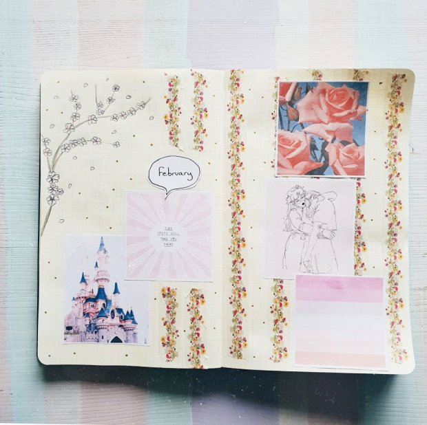 An image of my February monthly spread page - a double page spread with pink images including a Disneyland castle, a cherry blossom doodle, and line art of wlw
